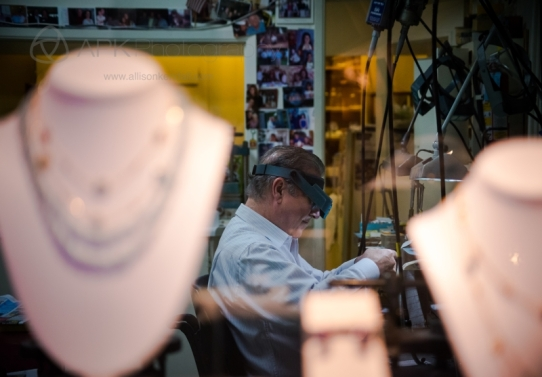 At a Carmel-by-the-Sea jewelry shop, a man works into the evening