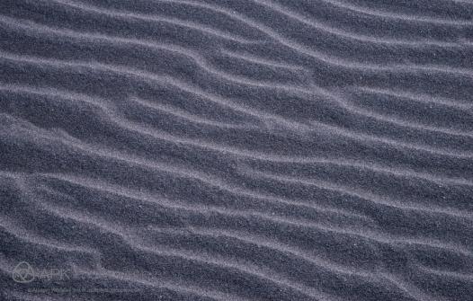 Black sands of Oakura Beach, New Zealand