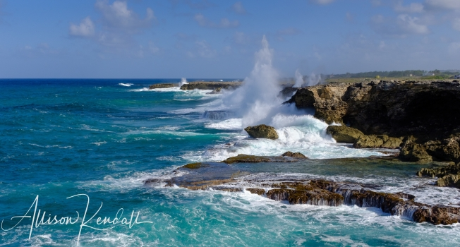 North Point, Barbados is a dramatic stretch of island coast, overlooking water in which the Caribbean Sea and Atlantic Ocean meet. The limestone cliffs and boulders are studded with fossilized coral, and the crashing waves have carved tunnels and blowholes through the rock.
