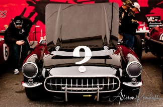 Race fans admire a 1957 Corvette at Laguna Seca during the Reunion events of Monterey Car Week