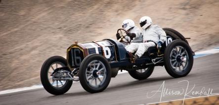 1912 Packard 30, descending through the corkscrew driven by Brian Blain at the Rolex Monterey Motorsports Reunion during Monterey Car Week